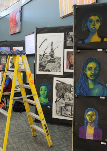 Art teachers worked hard to prepared for the 2nd annual winter art show. PHOTO/ Ayeh Attar