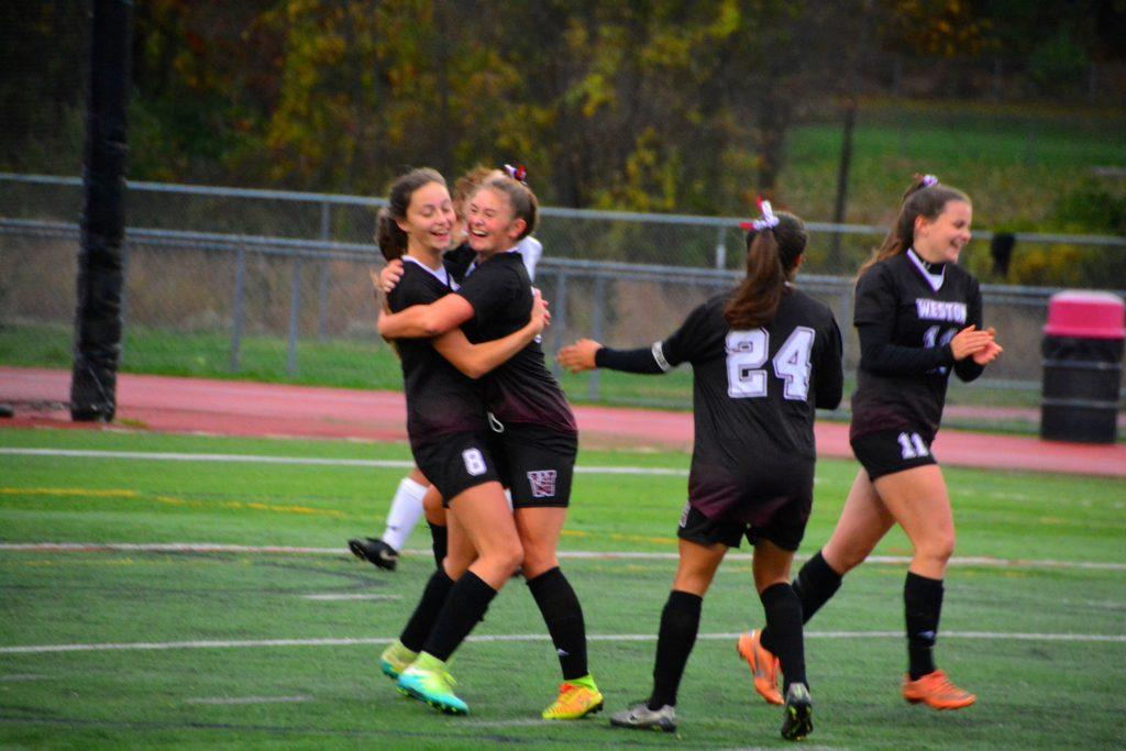 Teammates Mary Harding and Devon Parker celebrate a goal. PHOTO/ WGVS Parents
