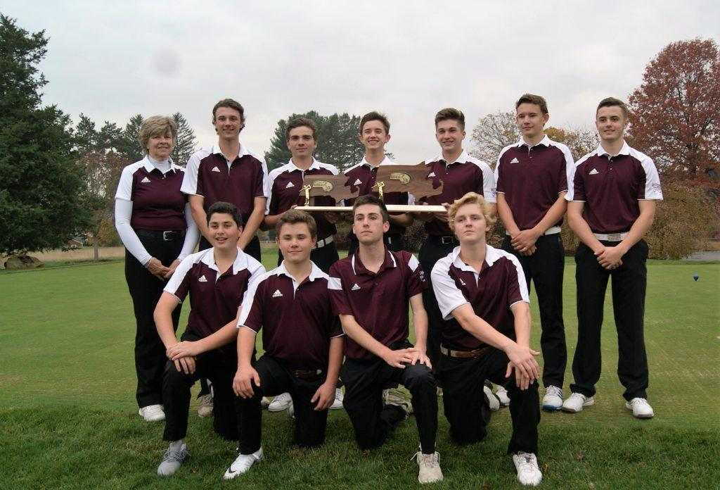 The golf team proudly displays their D3 state championship plaque. PHOTO/ Dana Markmann