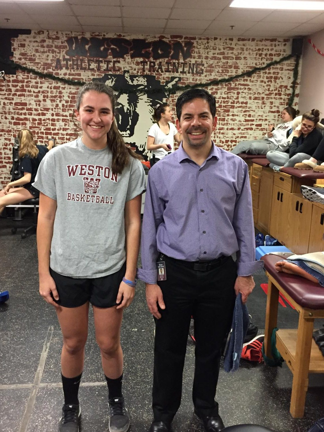 Weston Athletic Trainer Andrew Rizza stands alongside Junior Whitney Sins who recovered from a torn ACL and Meniscus and is back to playing varsity sports with the assistance of Rizza.