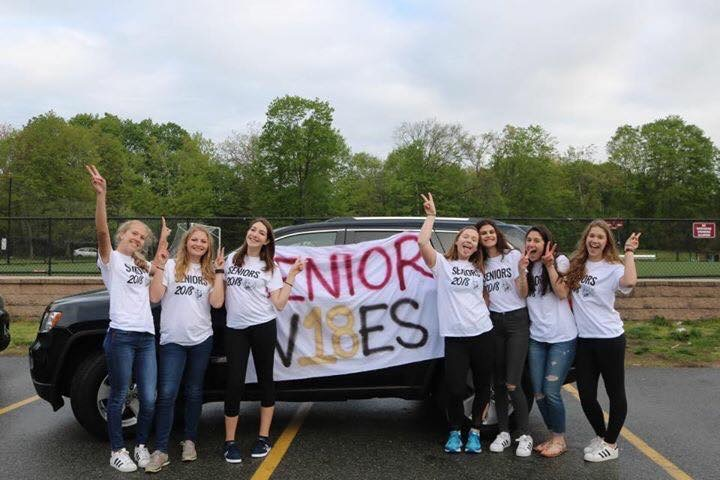 Seniors Kathryn Augustine, Kathrine Williams, Danielle Feinstein, Courtney Burrow, Kiara Snyder, Alina Hachigan and Mila Schowtka celebrating being seniors in the WHS parking lot.   PHOTO/Danielle Feinstein