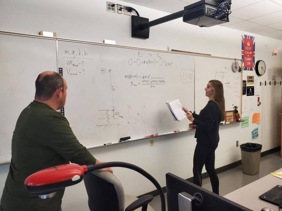 Science teacher Boris Korsunsky helps senior Lila Kosowsky solve a problem during an AP Physics class.