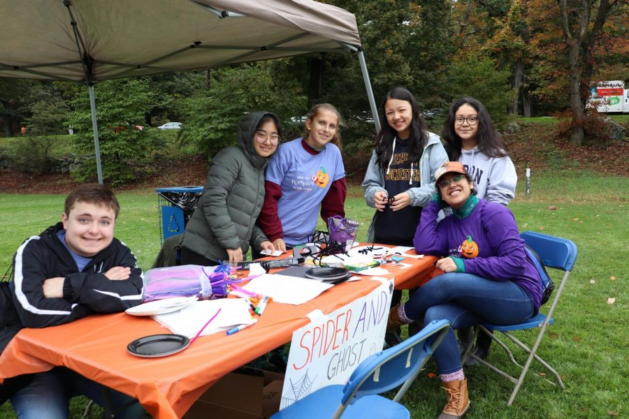 Left+to+right%3A+Seniors+Steven+LaValle+and+Joy+Mahoney%2C+along+with+juniors+Katherine+Cheston%2C+Allison+Oey%2C+Hannah+Callejas%2C+and+Shraddha+Lulla+volunteer+at+the+annual+Pumpkin+Fest.+