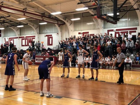 Junior Will Van Houten shoots free throw in game against Boston Latin.