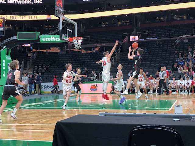 Junior Will Van Houten takes a jump shot against Waltham.