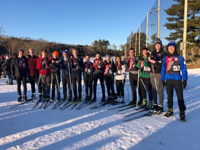 The nordic ski team poses for a group photo after a meet.