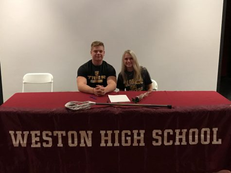 Hayden Zeller, Krissy Kakridas pose for a photo at the Weston High School.