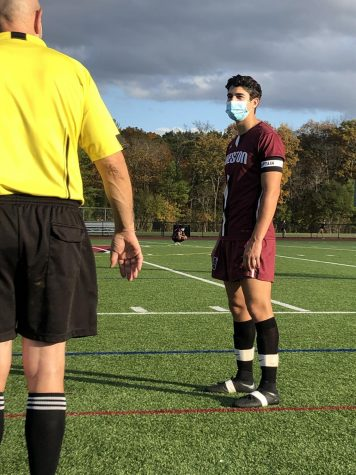 Senior Christos Iatridis wears a mask during the game.
