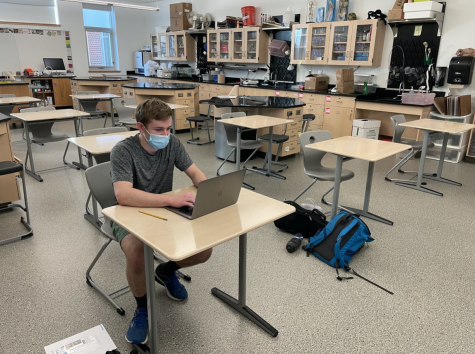 Senior Christopher Schott wrapping up his bio corrections while social distancing and wearing a mask.
