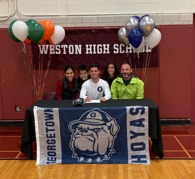 Jacob+Finard+with+his+his+family+as+he+signs+his+national+letter+of+intent+to+Georgetown+University.+