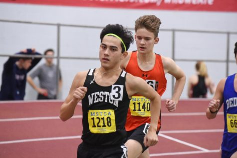Senior Nate Lathrop runs in meet last season.