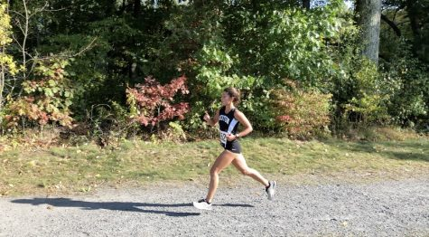 Senior and captain Phoebe Pohl competes in cross-country race.