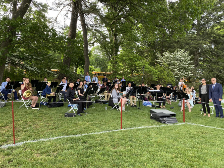 HS Band members set up before the 2021 graduation ceremony.