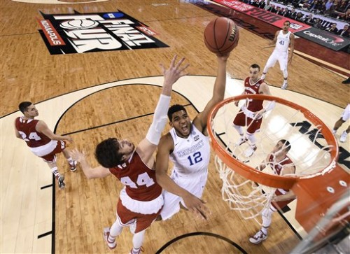 Kentucky and Wisconsin battle it out for a win in the NCAA Final Four game of 2015's March Madness. PHOTO/Chris Steppig