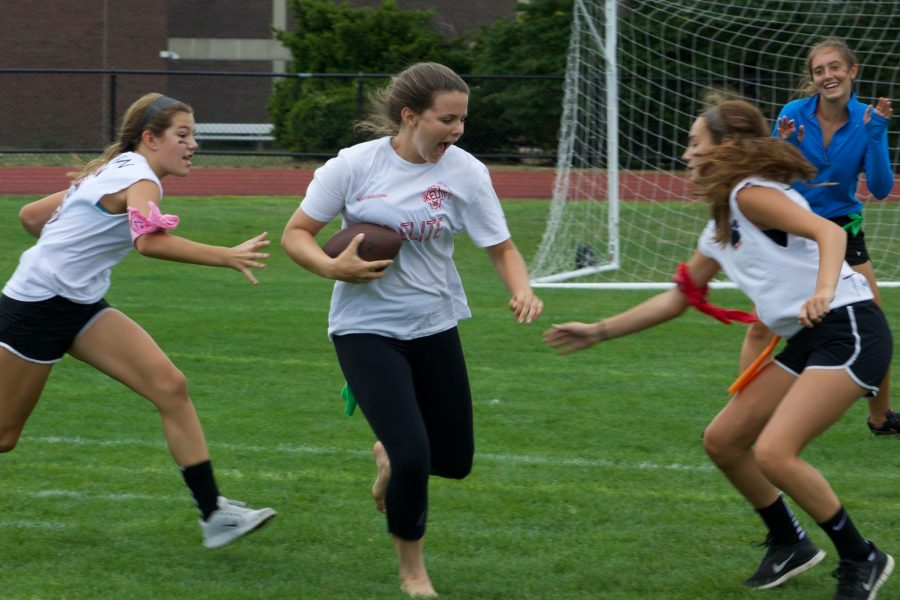 Sophomore MacKenzie Epperson avoids a tackle at Football for Fighters                    PHOTO / Kiana Summers