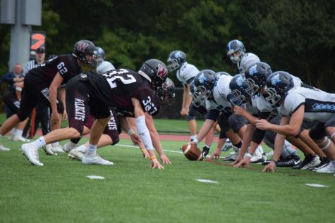 Weston lines up against Triton Regional High School's offensive line.