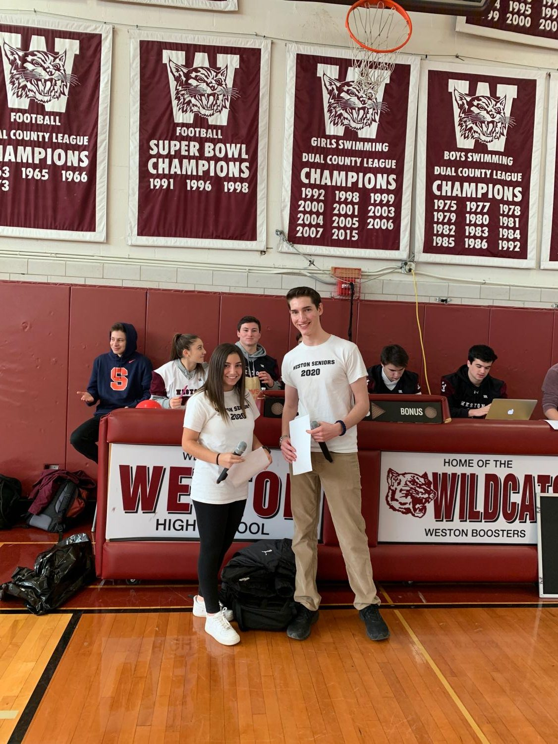 Senior co-emcees Becca Abrams and Ezra Gordon pose for a picture before the senior assembly.