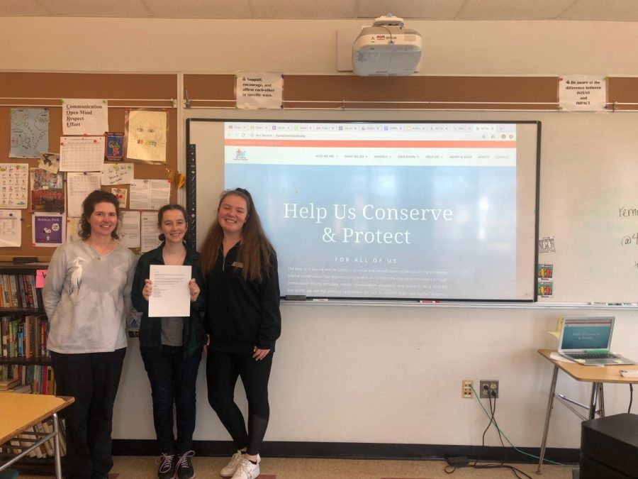 Left to right: Club advisor Elizabeth Riemer poses next to vice president Alyssa Azaam and president Madeline Tremblay.