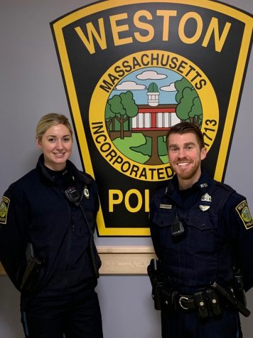 Officer Lindsey Arsenault and Officer Andrew Gribbons pose for a photo.
