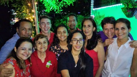 Ben Tremblay poses for a photo with his host family during his trip to Colombia.