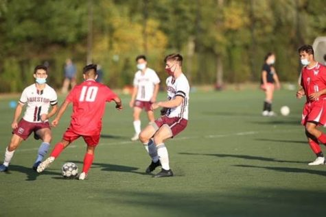 Senior co-captain's Jackson Tabors and Nick Ginovker defends a                                                                                                    Waltham player in their soccer match.