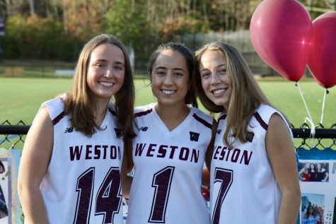 Field hockey captions Jackie Goode, Maya Malenfant, and Lily Heslem pose for a photo.