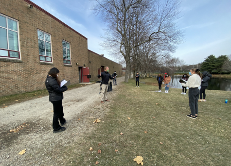 Mr. Eldridge conducting his class outside.