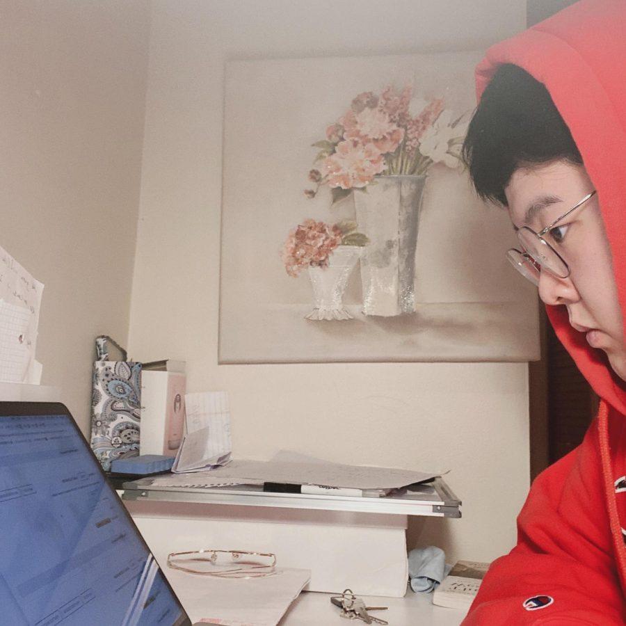 Senior Junbo Li works on his college applications.