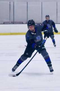 Current senior George Herlihy skates up the ice in game last season.