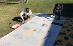Juniors Elizabeth Crawford and Natalie Ladocsi work on play prop.