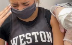 Student gets her second dose of the Pfizer vaccine.